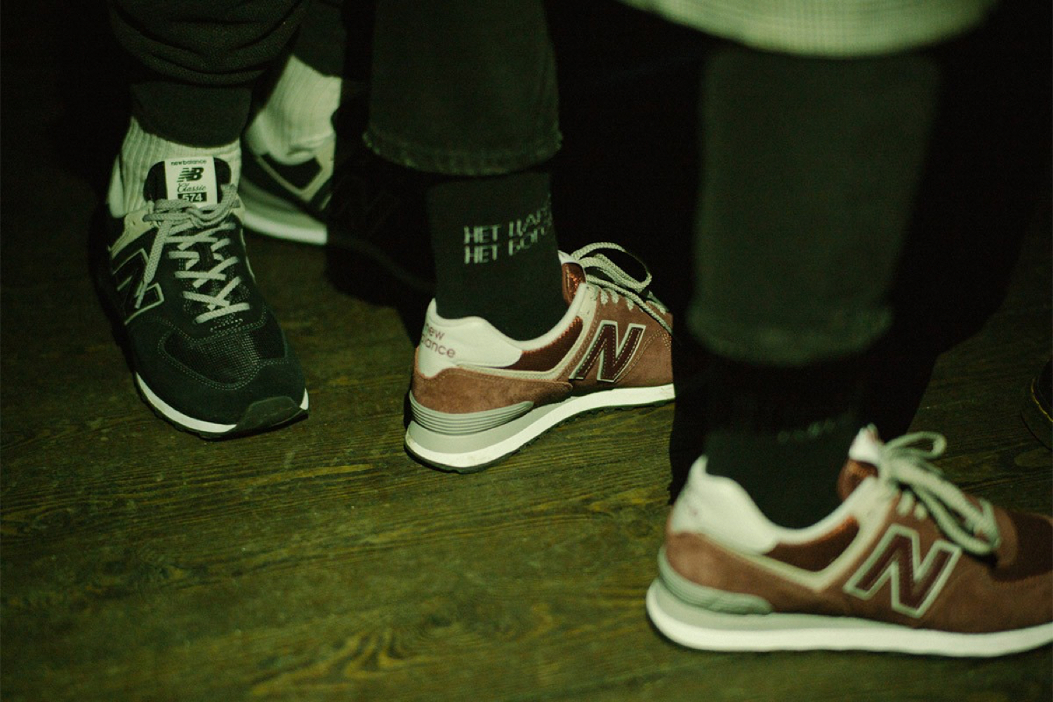Close Up shot of two people wearing new balance.