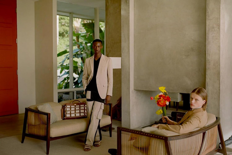 Two men posing in living room.