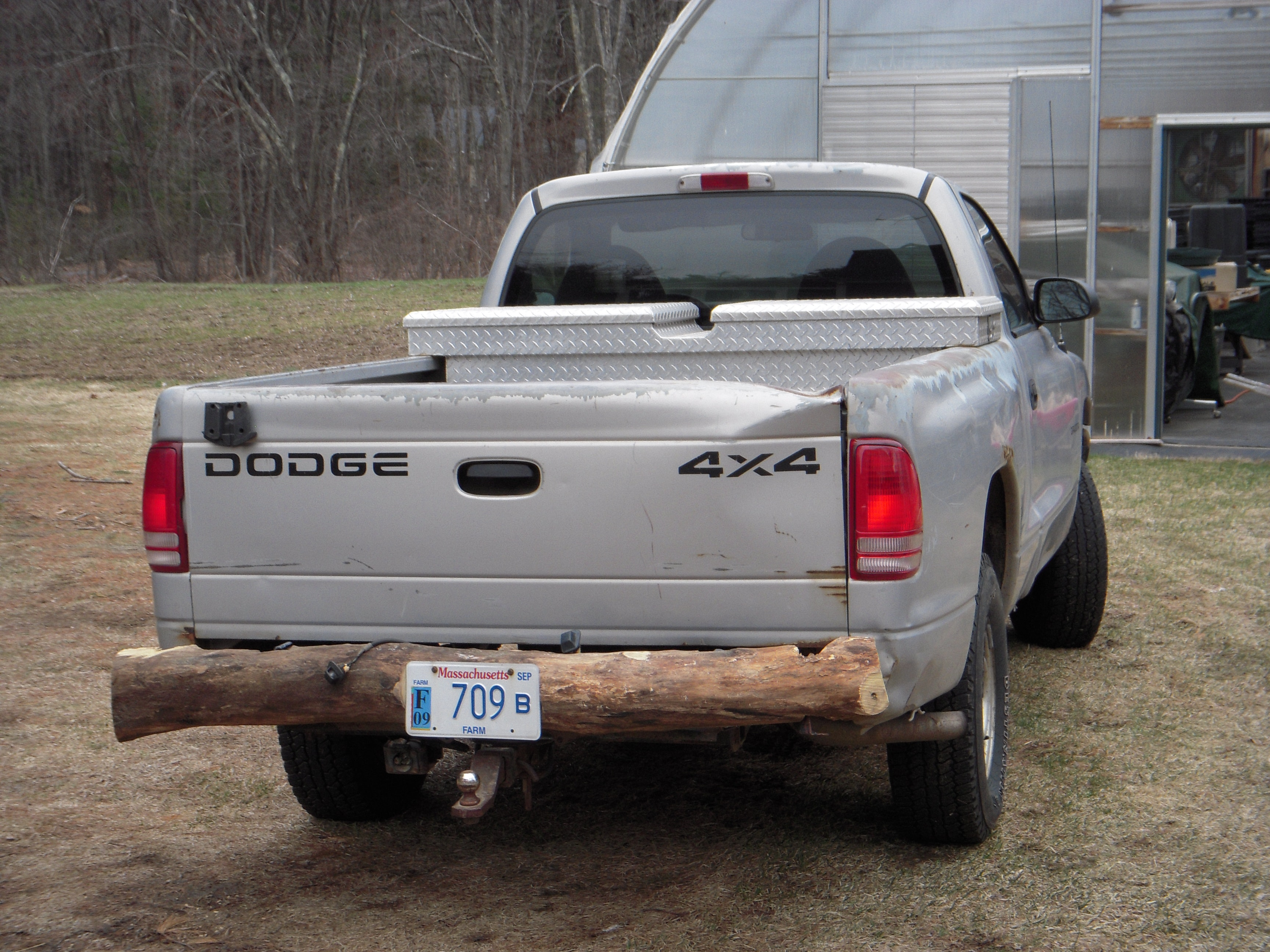 An image of a truck with a log for a bumper.