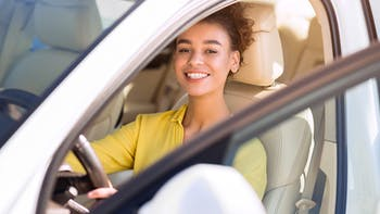 young woman learning to drive
