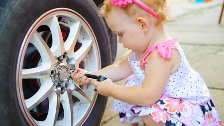 kid changing a tire