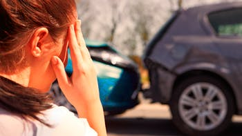 Girl in front of two collided cars