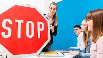 Driving teacher explaining the meaning of street sign