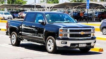 Black Chevrolet Silverado parked at a car show