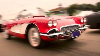 Vintage red Corvette on road