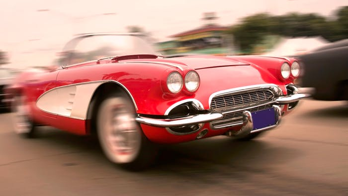 Vintage red Corvette on road