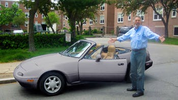 Tom standing in front of his miata
