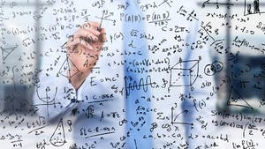 man solving math equations