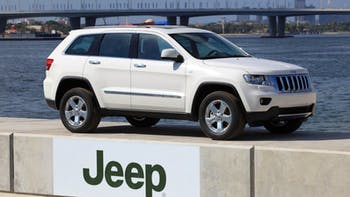 Jeep Grand Cherokee parked at the sea side