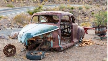 Old parts car in desert