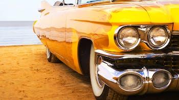 yellow car on beach