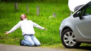 Man next to broken down car