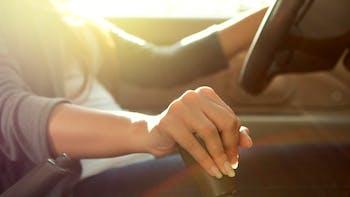 woman shifting car