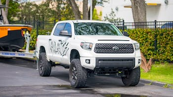 White Toyota Tundra parked in the side street