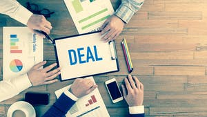 Business meeting sealing a deal