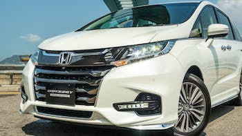 2018 White Honda Odyssey parked in the street