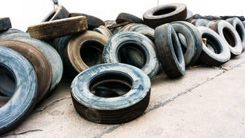Used car tires on a cement ground