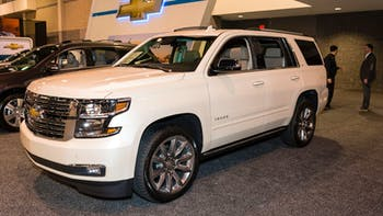 White Chevrolet Tahoe display during an auto show