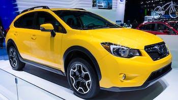 Subaru Crosstrek in Sunrise Yellow on display during an auto show
