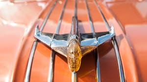 Chrome hood ornament on vintage Pontiac car