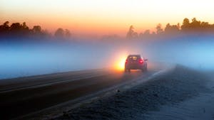 Car in the middle of the fog