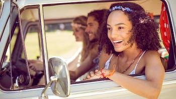 Hipster friends inside a van