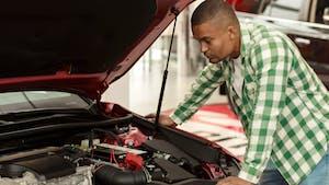 Man checking the car engine