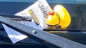 Toy duck in windshield