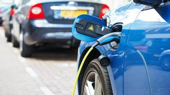 Charging Blue electric vehicle