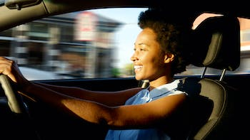 A young woman driving