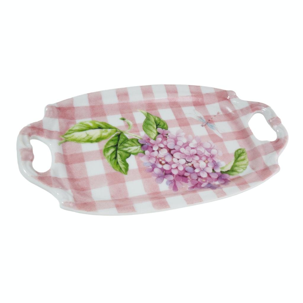 Peça de porcelana em formato de bandeja pintada de rosa e branco