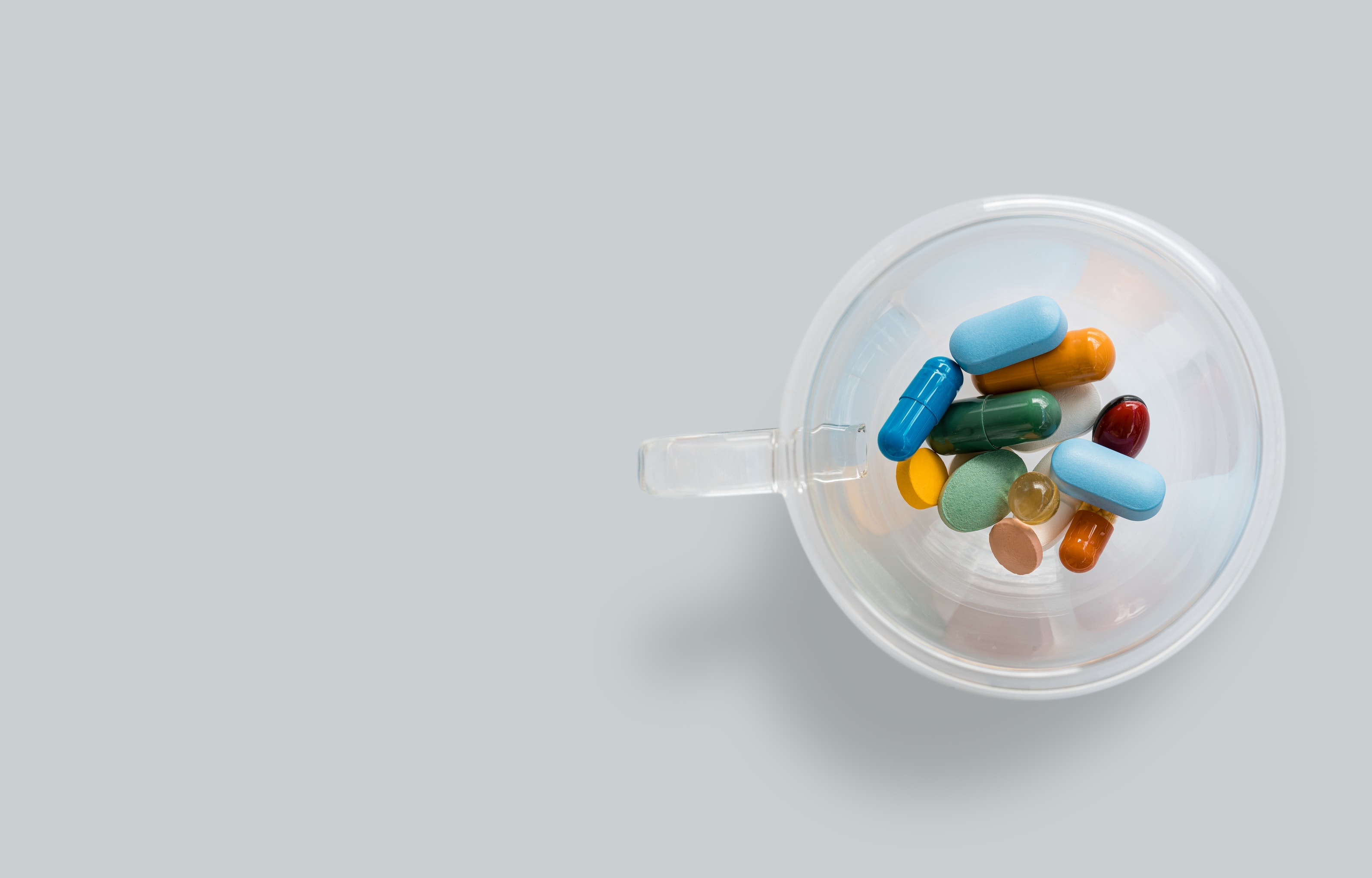 assorted physician-grade supplements in a plastic cup