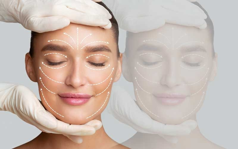 calm and smiling woman receiving a facial massage