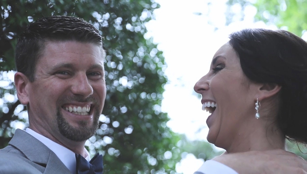 Kristine and Shane share a laugh after their wedding ceremony