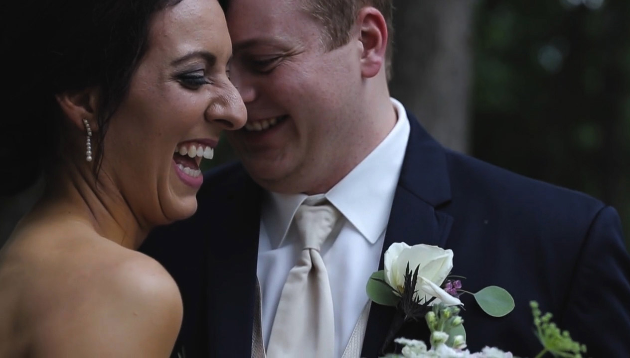 Adam and Kaylin laughing right after their wedding ceremony