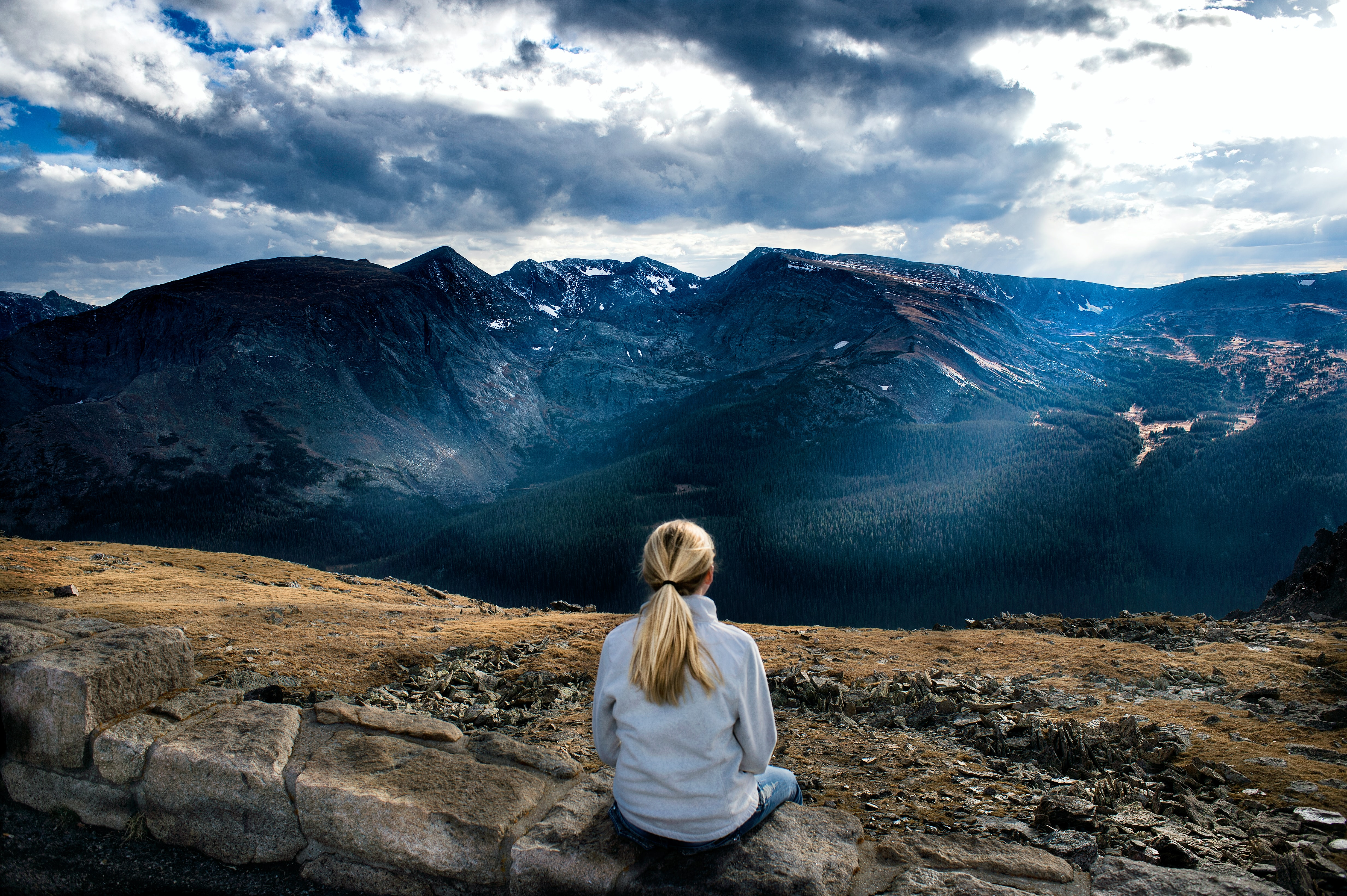 Women sitting in front of mountains