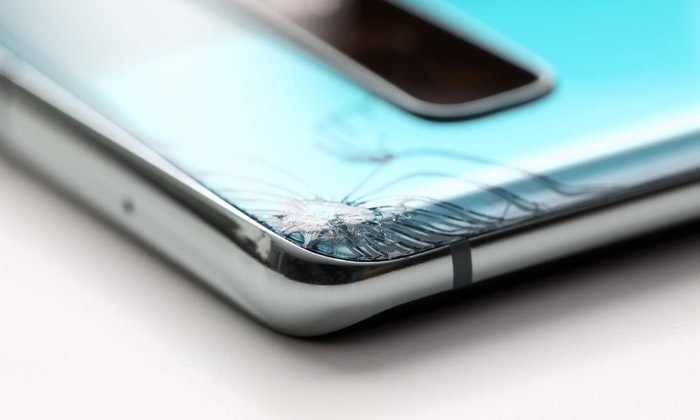 broken smartphone galaxy s10 laying on the table