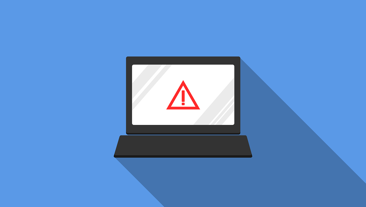 Laptop with warning icon