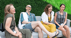 HashiCorp employees on a couch laughing