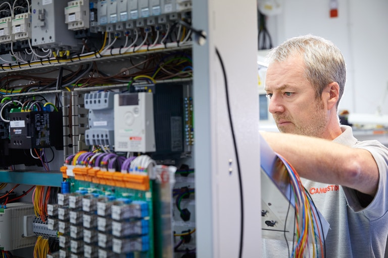 Cambustion test technician working on DPG wiring