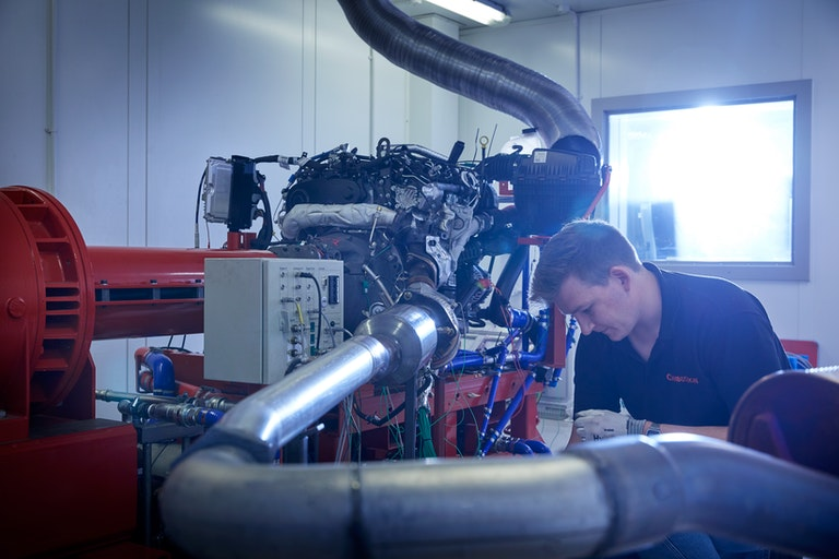 Cambustion engineer working on equipment in engine dynamometer