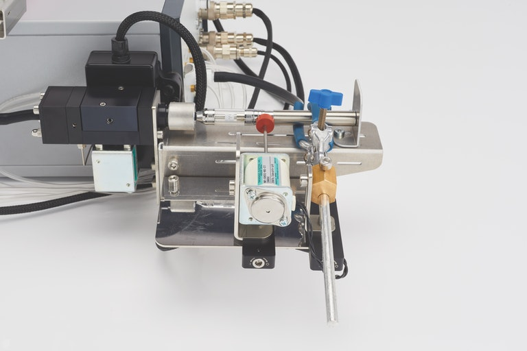 Cambustion SCS with button pusher for vape product development