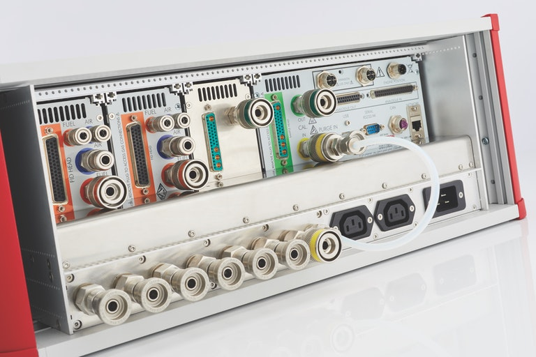 Rear of Cambustion FID600 cabinet showing gas fittings and module connections