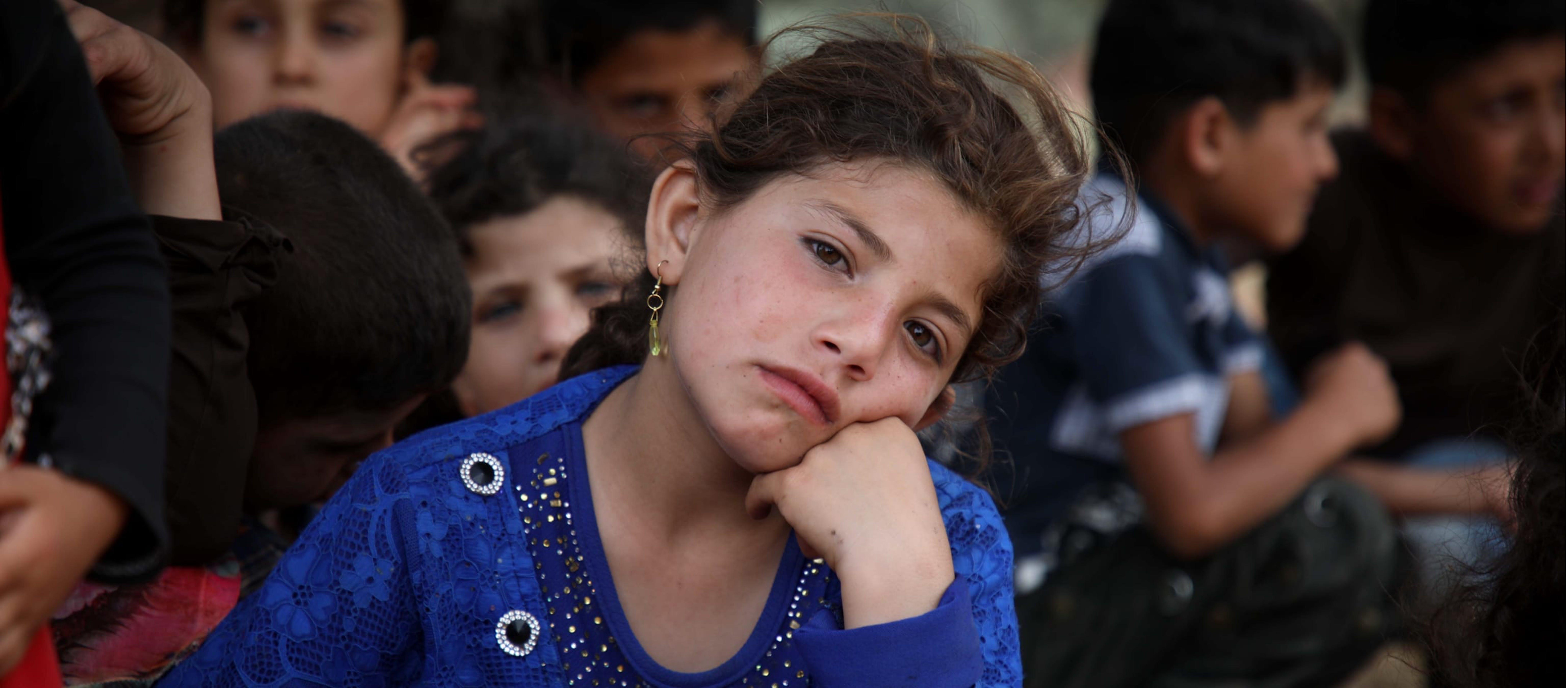 Rifugiata siriana in un campo di accoglienza vicino al confine turco