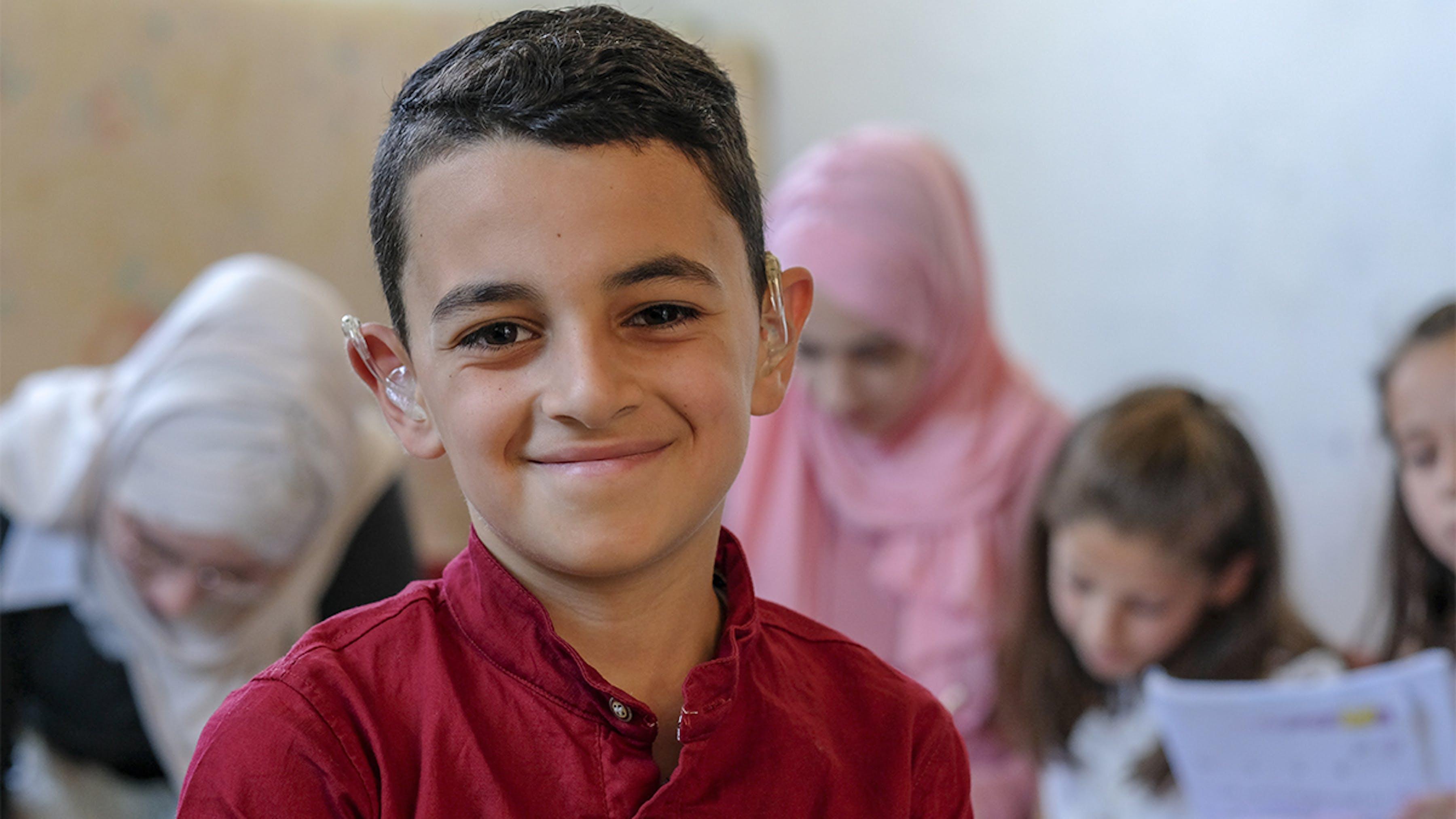 Giordania, la famiglia di questo ragazzo beneficia di un programma di trasferimento in denaro.