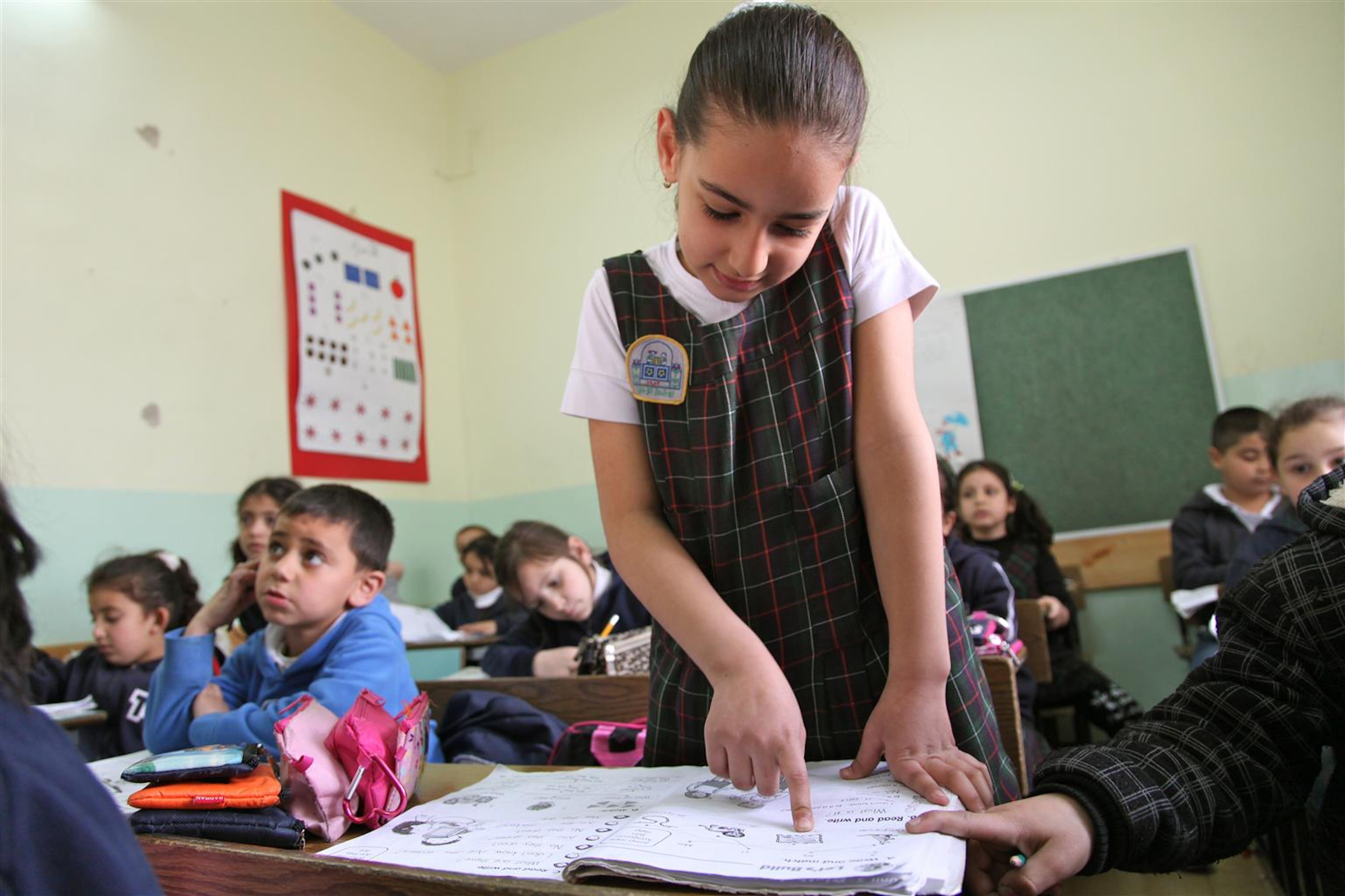 Una bambina palestinese durante una lezione. ©UNICEF/NYHQ2012-0314/Pirozzi