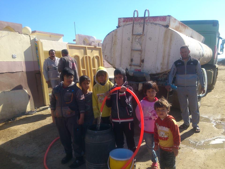 Una delle autocisterne dell'UNICEF che ogni giorno riforniscono gli sfollati nella provincia di Anbar (Iraq) con quasi 100.000 litri di acqua potabile - ©UNICEF Iraq/2014