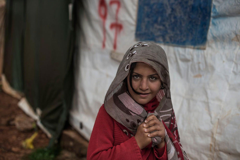 Una bambina siriana nel campo profughi di Marj El Khokh, in Libano - ©UNICEF/MENA2014-0010/Romenzi