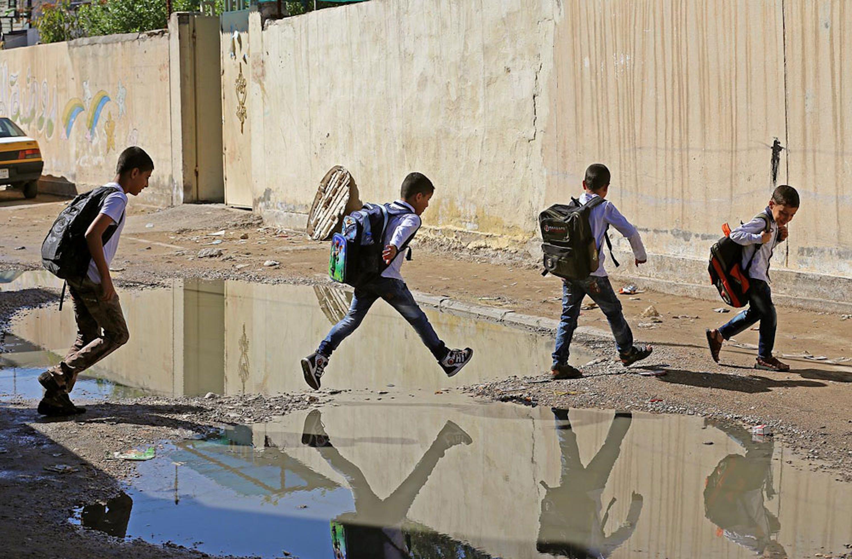 Strade allagate e fogne saltate a Baghdad e in altre zone dell'Iraq: condizioni che favoriscono l'espandersi del colera - ©UNICEF Iraq/2015-0323/Khuzaie