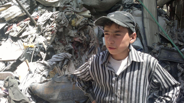 Un bambino di 13 anni fra le macerie della Città vecchia di Homs, sottoposta a 600 giorni di combattimenti - ©UNICEF/NYHQ2014-0817/Ali
